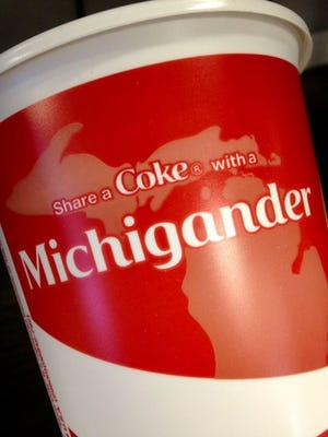 Check your soft drink cup from McDonald's starting Monday for a Michigan theme.