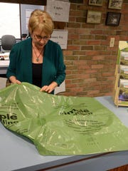 Canton households would receive recycling bags like this one shown in the Village of Milford by Clerk Debby Frazer.