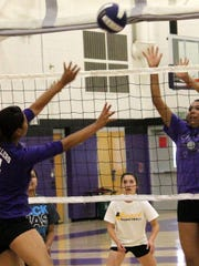 Lauryn Yuzos, left' tries to push a ball over Katelyn