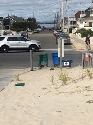 An explosive device discharged within a garbage pail at Seaside Park Saturday.
