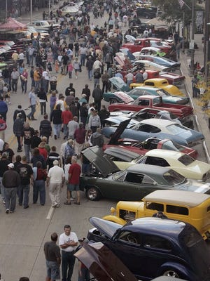 Car enthusiasts check out the cars along College Avenue in downtown Appleton during a past License to Cruise.