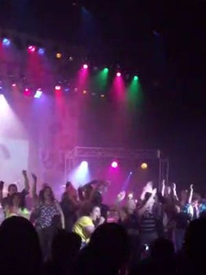 "In this image from video provided by Zach Rader students from Westfield High School are on the stage during the grand finale of the concert dubbed ""American Pie"" Thursday April 23, 2015 just prior to the stage collapsed."