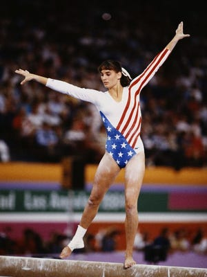 Tracee Talavera of the United States performs on the balance beam during the 1984 Summer Olympics in Los Angeles. Talavera, who coached gymnastics for 18 years after competing as an athlete, said she has seen lives ruined by abuse.