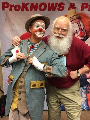 Randy Christensen as Simon De Clown, left,  with Leon (Santa) McBride.