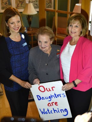 Lisa DiRado (left) welcomes former U.S. Secretary of State Madeleine Albright to her Northville Township home on Oct. 14.