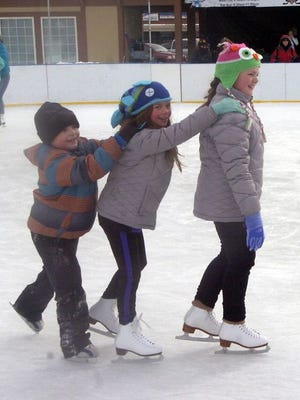 These skaters enjoy the ice last winter.