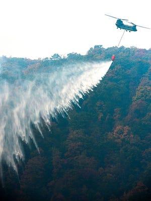 A South Carolina National Guard Chinook drops 2000 gallons of water on the fire at Pinnacle Mountain on Monday, November 14, 2016.