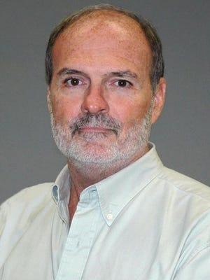 Columnist John Crisp