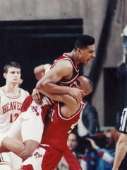 Paris McCurdy and Chandler Thompson celebrate an NCAA tournament victory en eroute to the Sweet 16 in 1990.