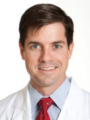 Dr. Mark Earl is an abdominal transplant surgeon and associate professor of transplant surgery at UMMC.
