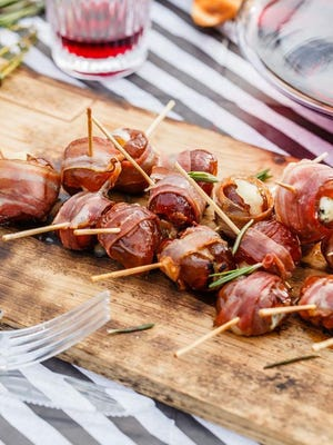 Bacon-wrapped, cheese-stuffed dates are perfect grab-and-go appetizers for party guests.