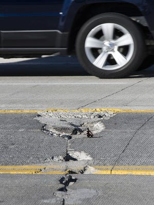 A pothole in the left-turn lane on Eight Mile. Wayne County says work to improve that lane will come later this year.