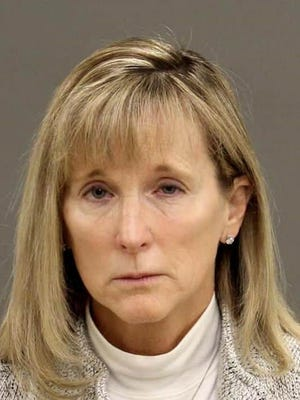 Debbie Broich, 52, of Pinckney embezzled more than $1 million from a staffing company, according to Bloomfield Township police.