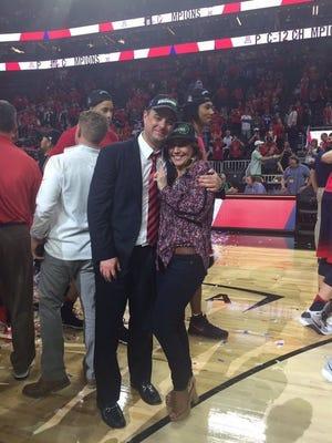 Sean and Amy Miller celebrate Arizona's Pac-12 Tournament championship.