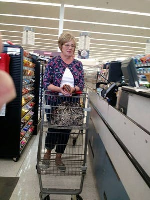 Marsha White, 59, of Bettendorf, helped pay for Jill Zimmerman's groceries on Tuesday, April 18, 2017, at a Hy-Vee in Bettendorf. Zimmerman, who was ahead of White in line, told the cashier she was without her EBT card and White offered to pay the bill.