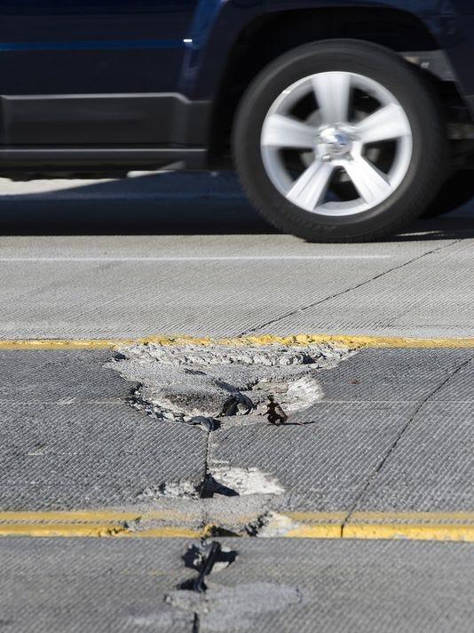 636295866363281400-Eight-Mile-pothole.jpg