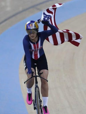Brownsburg's Chloe Dygert Owen celebrates her gold medal in individual pursuit at track cycling's World Championships in Hong Kong.