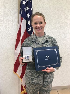 1st Lt. Ali Joseph shows off an Air Force achievement medal for meritorious service that she received Thursday. Joseph, whose husband is Phillies first baseman Tommy Joseph, is a labor and delivery nurse in the Air Force.