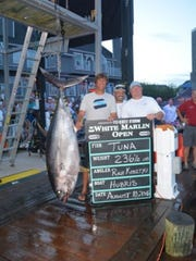 (L-R) Rich Kosztyu, Hamilton, Damien Romeo, Lacey, owner and captain of the Hubris, and Brian Suschke, stand with the 236 1/2 pound bigeye tuna they caught Aug. 10, 2016 at the White Marlin Open.