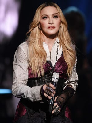 Madonna grew up in Rochester Hills, Michigan.