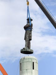 A statue of Robert E. Lee is removed in New Orleans