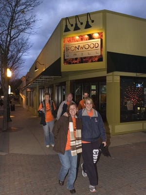 Friends leave Ironwood Grill during a previous Penn-Taste-Tic restaurant crawl in downtown Plymouth.