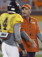 Virginia Tech coach Justin Fuente works with Hokies