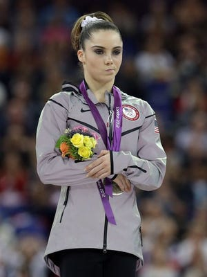 U.S. silver medallist gymnast McKayla Maroney gestures during the podium ceremony for the artistic gymnastics women's vault finals at the 2012 Summer Olympic in London.