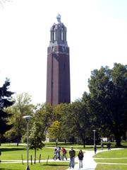 Students cross the South Dakota State University campus near the campanile in Brookings.