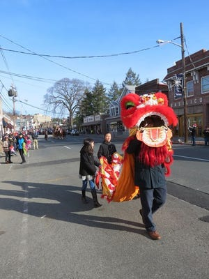 Jack Ouyang, of the Millburn-Short Hills Chinese Association, marches a lion down Millburn Avenue as part of the township's Snowflake Parade, an annual event hosted by the business group, the Downtown Millburn Development Alliance. The group picked officers last Friday.
