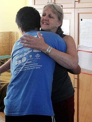 John Nye, 22, left, greets his mother Cathi Nye as she makes a visit to his apartment.
