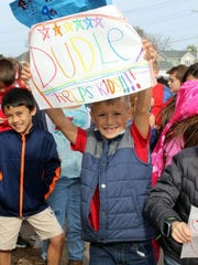 Salvatore Piazza, a Dudley Elementary School student, shows off the sign he created for the 2017 Fall Crawl. It was one of many the students carried during the almost one-mile walk around the schools.