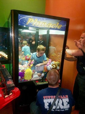 A boy became trapped inside an arcade game in Titusville, Fla., Wednesday.