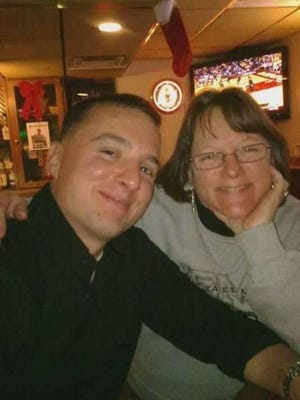 """Teresa Dillinger, of Union Township, and her son, Mark Anthony """"Wojo"""" Wojciechowski, who was killed in combat in Iraq in 2009."""
