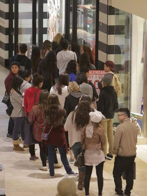 Shoppers wait in line for a store to open on Black Friday 2015 at The Oaks shopping center in Thousand Oaks. Though the city's premiere mall has some vacancies, it also boasts a robust 93 percent occupancy rate, but faces e-commerce competition.