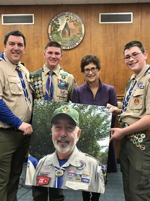 Members of Boy Scout Troop 17 of St. Rose of Lima Church get their wish on March 6, 2018, as the Millburn Township Committee approves an ordinance that renames a portion of Canoe Brook Road after the late Scoutmaster Ken Fineran.
