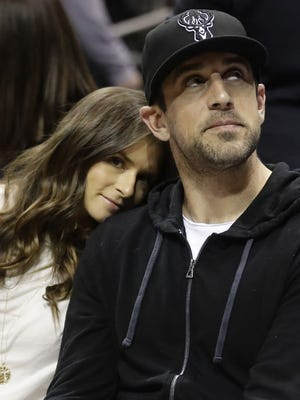 Danica Patrick and Aaron Rodgers watch Game 3 of a first-round playoff series between the Milwaukee Bucks and the Boston Celtics on April 20.