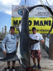 The 467-pound thresher shark caught aboard the Miss Ginny.