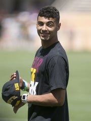 A young Manny Wilkins rocks a beardless look.