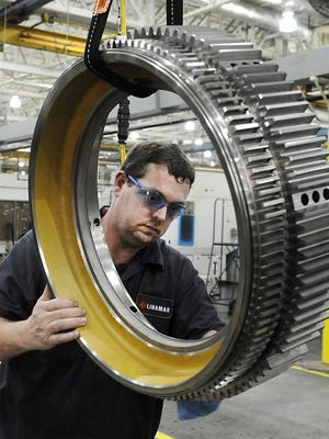 Neil Metcalf cleans and inspects a hub piece at Linamar in South Asheville. Linamar makes engine blocks for Volvo and hubs and anchors for Caterpillar heavy equipment.