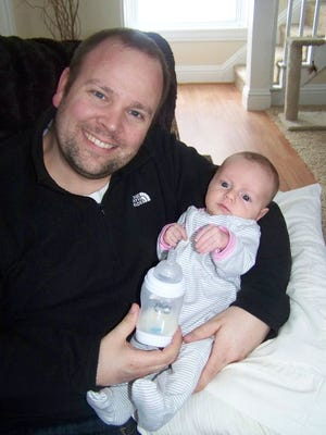 Joshua Quincy Burns holds his daughter, Naomi Burns, in this undated family photograph. He is serving a county jail sentence for child abuse against his daughter, now 1.