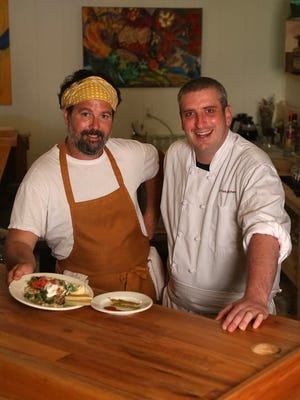 Eric Menzel, left, of Salt Fork Farms collaborates with Jay Schworn of Salt Fork Kitchen to provide made-from-scratch, locally sourced foods in Solon.