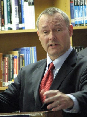 Iowa State Treasurer Michael Fitzgerald talks in 2012 to a group of Lincoln High School students about learning to manage credit wisely.
