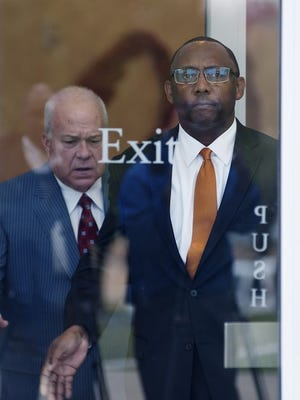 Former Corrections Commissioner Chris Epps emerges from the federal courthouse with his lawyer, John Colette of Jackson.