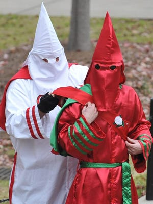 Members of the Ku Klux Klan dress in full robes for a protest Nov. 21, 2009, on the steps of Fulton Chapel at the University of Mississippi in Oxford.