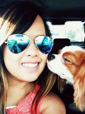 Nurse Nina Pham, 24, of Dallas with her dog.