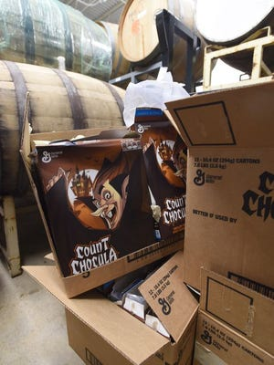 Empty boxes of Count Chocula cereal await to be recycled.