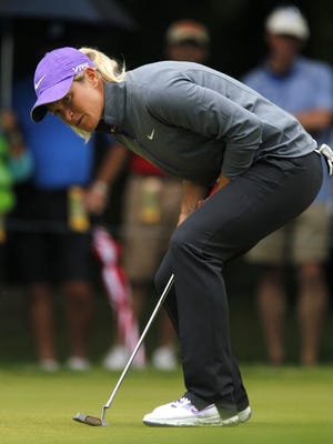 Suzann Petterson watches her birdie putt fall on No. 14 during the third round of the Wegmans LPGA Championship at Monroe Golf Club. She is one shot out of the lead.