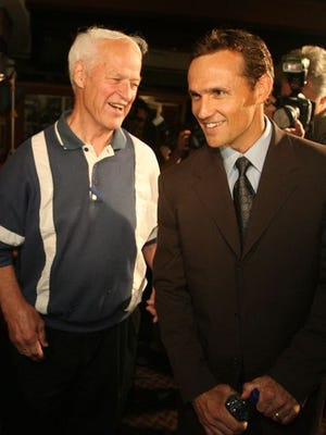 Steve Yzerman, right, meets with Gordie Howe after Yzerman announced his retirement.