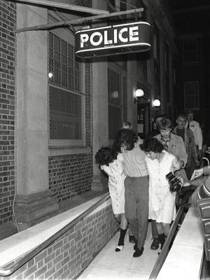 Police lead Kathy Boudin, David Gilbert and Judith Clark into the Nyack Police Station after they were charged in the killing of two Nyack officers and a Brinks guard on Oct. 20, 1981.